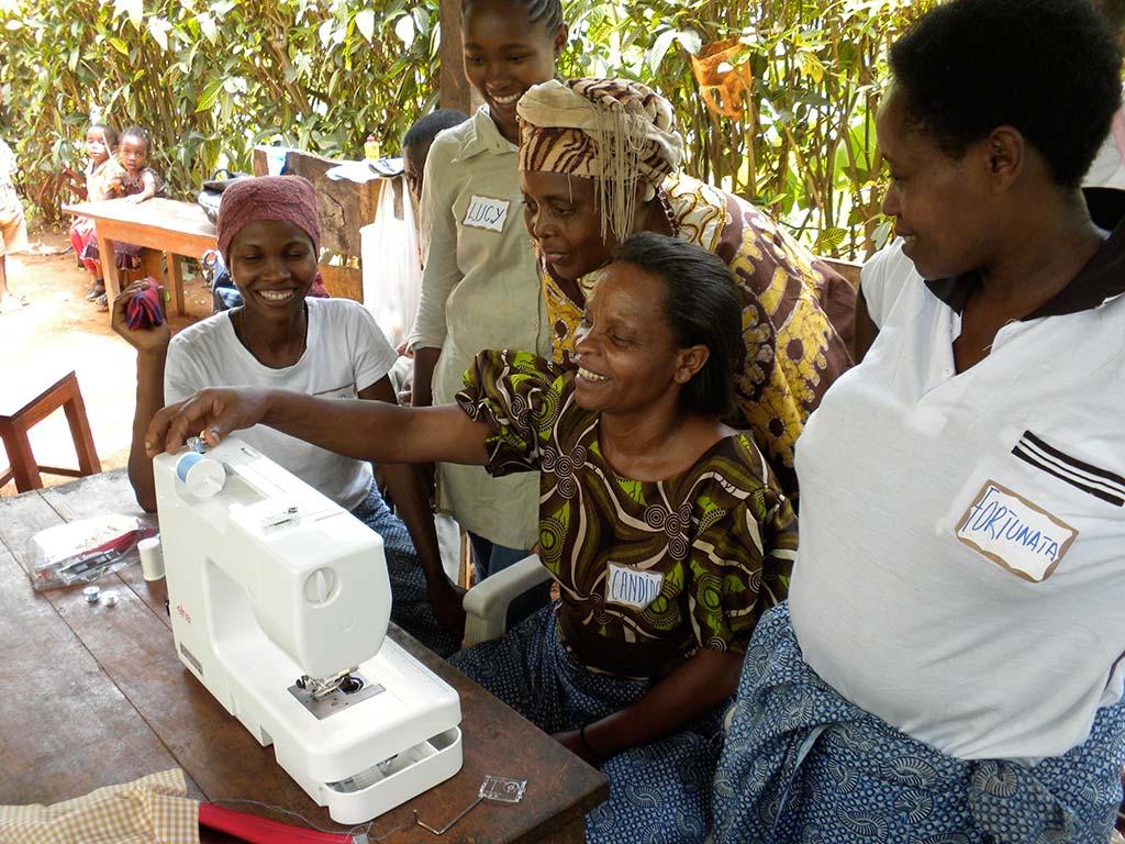 Acorn women at a sewing machine
