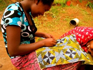 Lucia sewing with Acorn Women's Cooperative